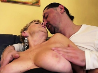 Busty grandma gets cummed