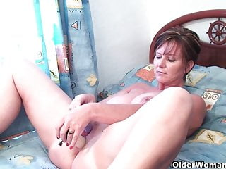 Classy grandma pushes dildo up her ass