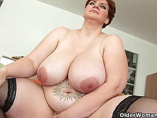 Voluptuous old woman with huge tits fucks a dildo
