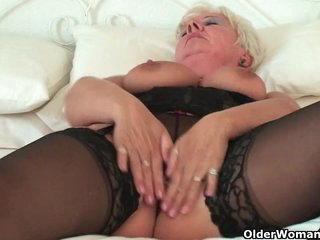 Curvy granny in dark nylons rubs her old love button