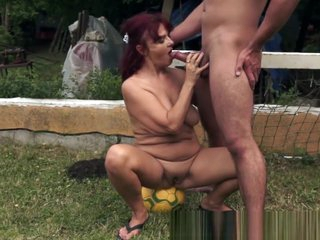 Redhead granny rides and sucks cock outdoors